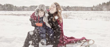 Mother and son playing in snow Royalty Free Stock Images