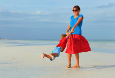 Mother and son playing on summer beach Stock Image