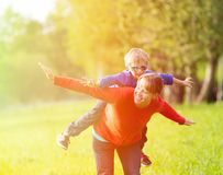 Mother and son playing in summer park Royalty Free Stock Photo
