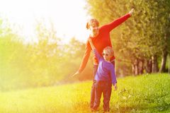 Mother and son playing in summer park Royalty Free Stock Image