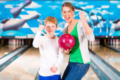 Mother and son playing together at bowling Royalty Free Stock Photos