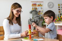Mother and son Playing together with colorful didactic toys stock photos