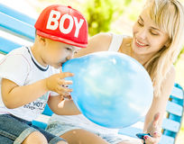 Mother and son playing. Together outdoors in park with soap bubbles Stock Photography