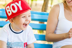 Mother and son playing. Together outdoors in park with soap bubbles Royalty Free Stock Photography