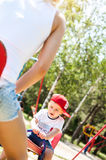 Mother and son playing. Together outdoors in park with soap bubbles Royalty Free Stock Photo