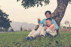 Mother son playing toy together Stock Photos