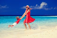 Mother and son playing on tropical beach Stock Image