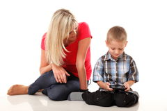 Mother and son playing video game on smart phone Stock Image