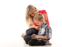 Mother and son playing video game on smart phone Royalty Free Stock Image