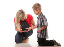 Mother and son playing video game on smart phone Stock Photography