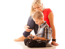 Mother and son playing video game on smartphone Royalty Free Stock Images