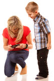 Mother and son playing video game on smartphone Stock Photos