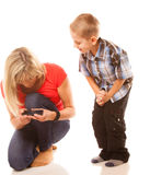 Mother and son playing video game on smartphone Royalty Free Stock Image