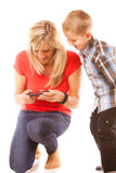 Mother and son playing video game on smartphone Royalty Free Stock Photos