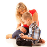 Mother and son playing video game on smartphone Royalty Free Stock Photo