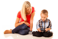 Mother and son playing video game on smartphone Royalty Free Stock Photography
