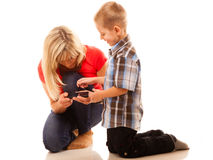 Mother and son playing video game on smartphone Stock Images