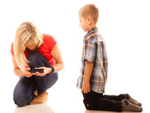 Mother and son playing video game on smartphone Stock Photo