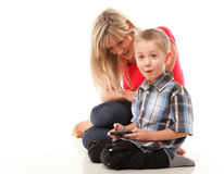 Mother and son playing video game on smart phone Stock Photo