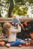 Mother and son playing in the yard in the village Royalty Free Stock Photos