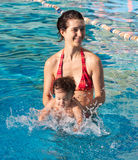 Mother with son in pool Stock Photos