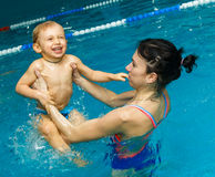 Mother and son in the pool Stock Photography