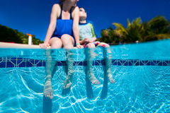 Mother and son by the pool Royalty Free Stock Photography
