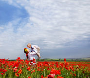 Mother and son on the poppies field Royalty Free Stock Photo