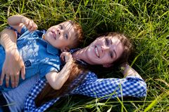 Mother and son portrait against green trees family stock photos
