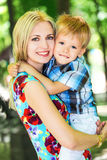 Mother with son. Portrait of mother with son in the garden Royalty Free Stock Images