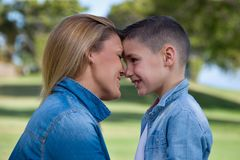 Mother and son. Portrait of mother and son on green background. child and mom walk in the summer park Royalty Free Stock Photography