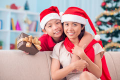 Mother and son. Portrait of happy little boy and his mother looking at camera on Christmas evening Royalty Free Stock Photos