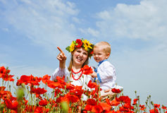 Mother and son portrait in poppies field Royalty Free Stock Image