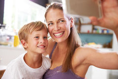 Mother And Son Posing For Selfie At Breakfast Table Royalty Free Stock Image