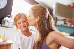 Mother And Son Posing For Selfie At Breakfast Table Stock Images