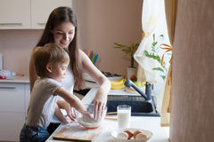 Mother and son prepare pie with flour Stock Images