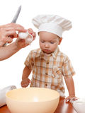 Mother and son preparing cake in the bowl of a blender. White background Royalty Free Stock Image