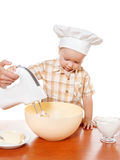 Mother and son preparing cake on a white background. Kids and mother baking. Children and parent cooking. Little boy cook and bake in a white kitchen with modern Stock Images