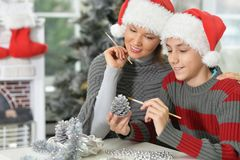 Mother with son preparing for Christmas. Portrait of young mother with son preparing for Christmas Royalty Free Stock Photos
