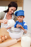 Mother and son preparing dough. Together Royalty Free Stock Photos