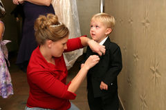 Mother and son preparing for wedding Royalty Free Stock Photos