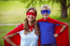 Mother and son pretending to be superhero Stock Photo