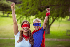 Mother and son pretending to be superhero Royalty Free Stock Images