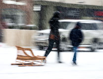Mother with son pulling sleds Stock Images