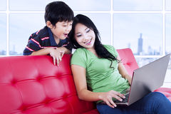 Mother and son quality time with laptop at apartment Royalty Free Stock Image