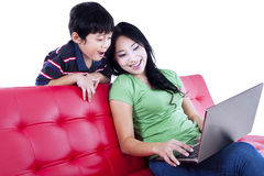 Mother and son quality time on red sofa - isolated Stock Photos