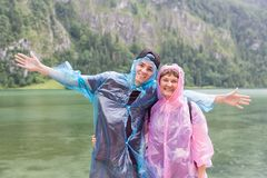 Mother and son with raincoats at coast of German Konigssee Stock Images