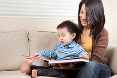 Mother and son reading. A portrait of a mother and a son reading a book Stock Photography