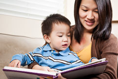 Mother and son reading Stock Photos