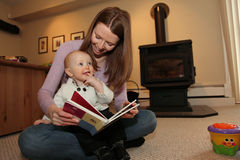 Mother Son reading. Young mother reads book to son stock photography